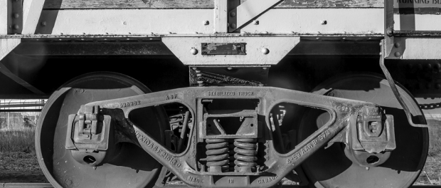 Photo of the train wheels on an old box car