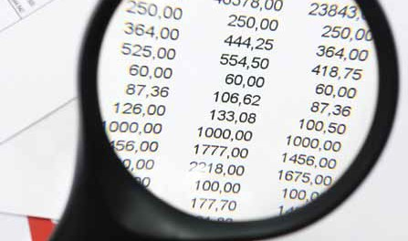 Image of magnifying glass viewing accounting figures