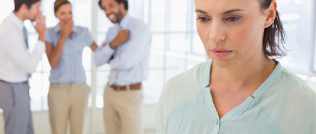 Photo of woman looking away for others talking behind her back